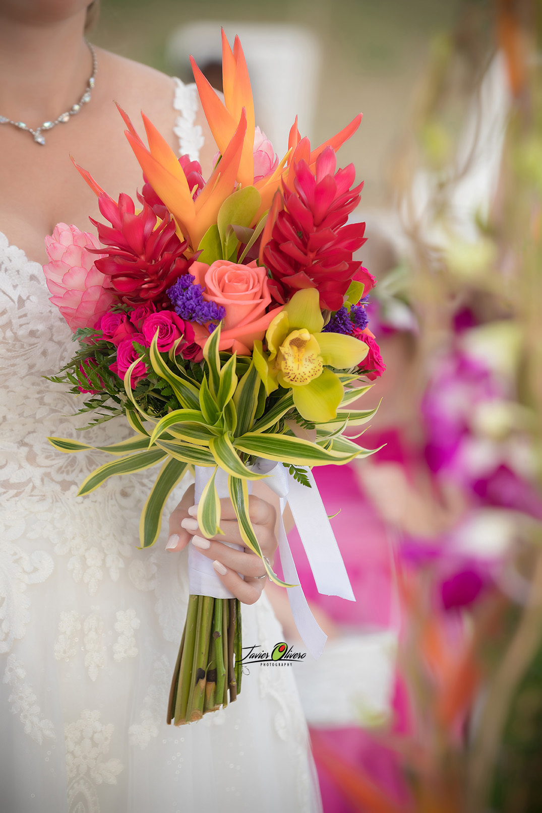 colorful tropical bouquet with gingers, roses & orchids