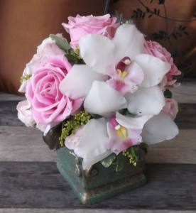 White cimbidium orchids, paired with delicate pink roses make this small design perfect for a first love, favorite aunt or grandmother. - $42