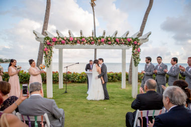 copamarina wedding arch w flowers across the top