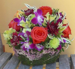 Love colors? Rock Star roses, green kermit poms, & purple dendrobium orchids pop in this bright spring design. Available in 2 sizes: small - $45; medium - $55
