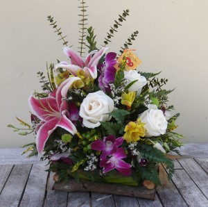"""This country inspired collection of mixed blooms and tropical foliage exudes a rustic vibe. Approx. 16"""" H x 12"""" W. Our Price: $65"""