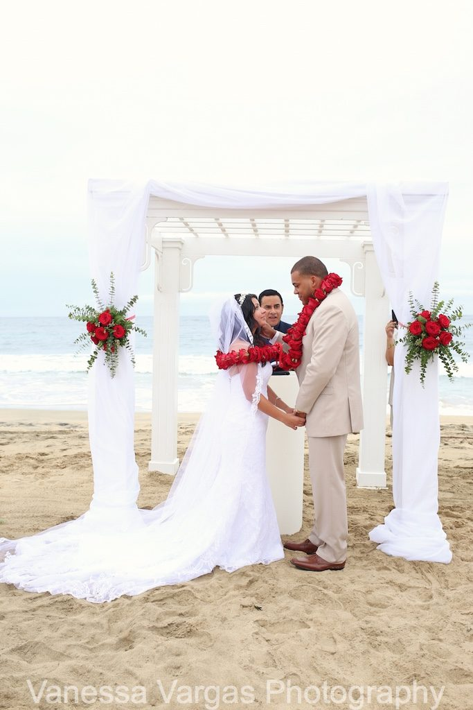 white arbor on beach - red & white wedding