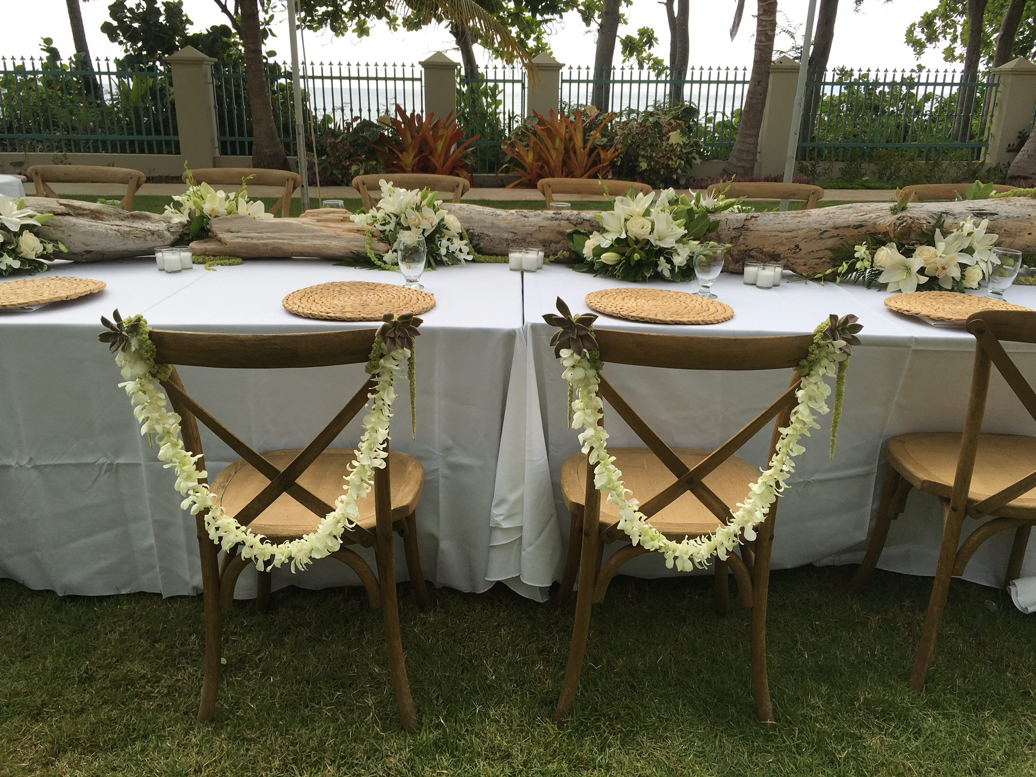 white orchid leis w/ succulent for chair decor