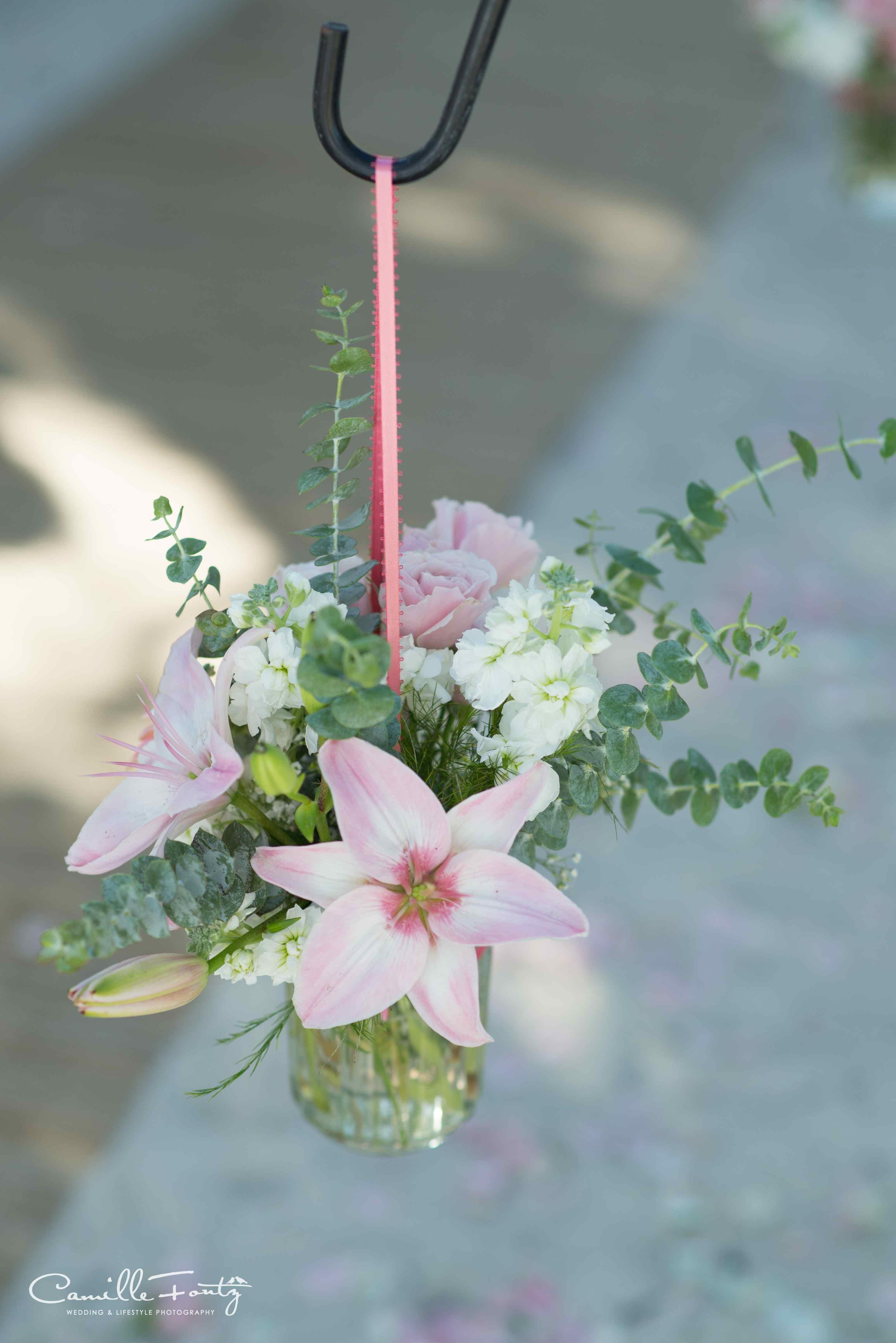 pink lilly & eucaliptus hanging from shepherds hook